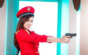 Luscious Thai shemale B posing in a uniform and spreading her pussy