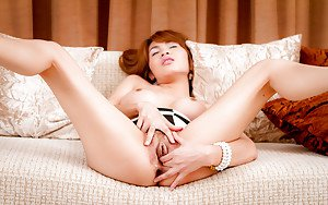 Redhead Asian ladyboy Diana plays on the sofa with her new toy