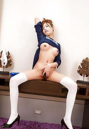 Asian shemale schoolgirl Chimi plays with her dildo in the classroom