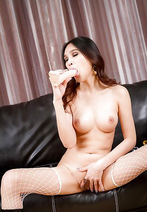 Young and pretty ladyboy model Yaya likes her huge toy very much
