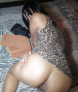 Dark haired Asian ladyboy Paty giving a hard dick a sloppy blowjob
