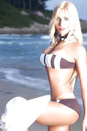 Gorgeous blonde European shemale Suzane Petrovyk showing off her nice ass
