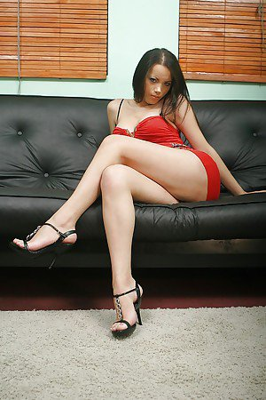 Asian tranny Deborah strikes sexy solo poses in high heels and jerking off