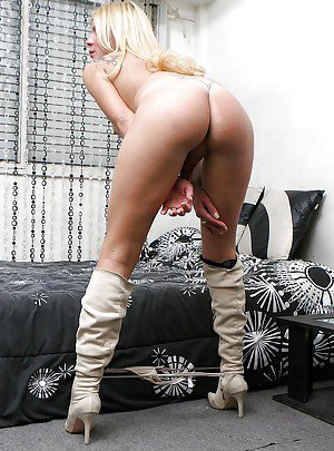 Wearing boots and lingerie tranny Melina spends her time masturbating