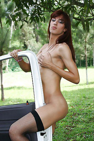 Tall and skinny Latina shemale Michelli Cerqueira posing in nude outdoors