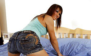Gorgeous redhead Asian tranny loves to jerk off in her bedroom