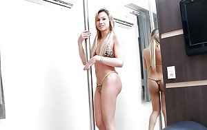 Blonde Latina tranny Gaby Abelha works the stripper pole before jerking off
