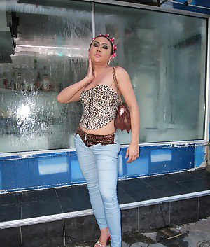 Big tit Asian tranny spreading her nasty ass and posing outdoors