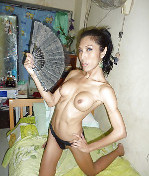 Skinny Asian tranny showing off her big tits and hairy asshole