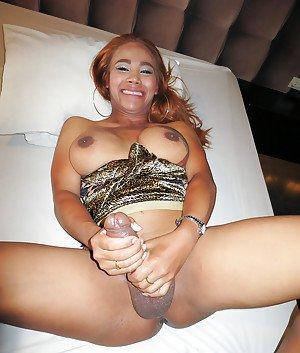 Filthy Asian tranny Jasmine jerking off hung cock for cumshot on belly
