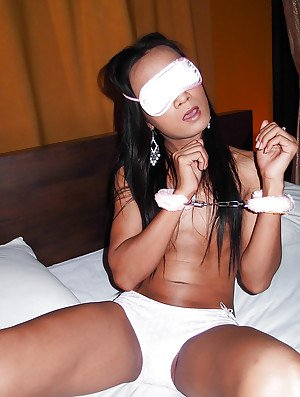 Submissive Asian ladyboy Sai is handcuffed and blindfolded for bareback