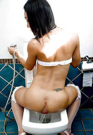 Tiny Thai shemale Tuk jerking off hung cock in fishnet stockings