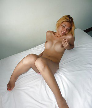 Busty Asian tranny flashing her big shemale breasts in public