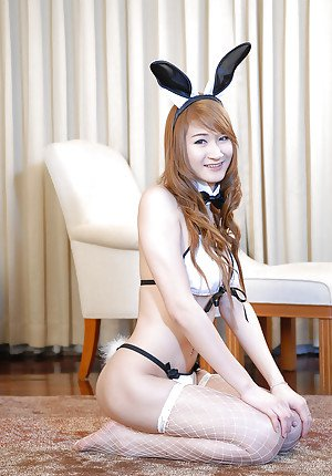Cute Thai shemale Pond 2 jacks off shedick in Playboy Bunny uniform