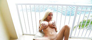Busty blonde shemale Ana Mancini flashes her huge tranny tits outdoors