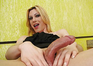 Solo shemale model Isabella A jerking off her huge tranny cock