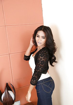 Sexy Latina shemale Champagne pulls down jeans and whips out shaved cock