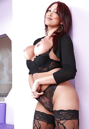 Pretty Latina shemale Amanda C spreading ass in stockings and high heels