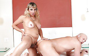 Busty Latina shemale in pantyhose and heels barebacks man's butthole