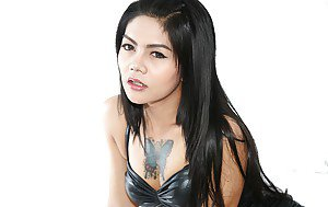 Pretty Thai ladyboy Manow pulls down panties to bare shaved she-dick