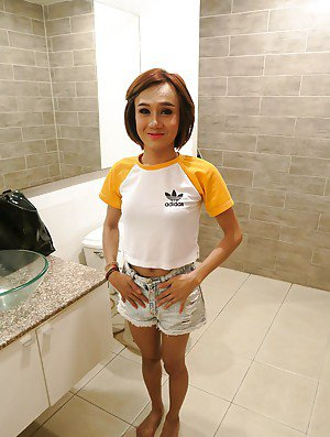 Skinny Asian ladyboy Nenynan showing off flat chest in shower