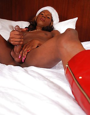 Solo ebony shemale jerking off massive black cock at Christmas
