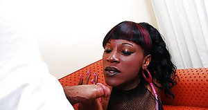 Ebony chick with dick Amber letting BBC hang loose while giving blowjob