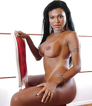 Ebony shemale Ambra Veruty flaunting perfect trans boobs during solo poses