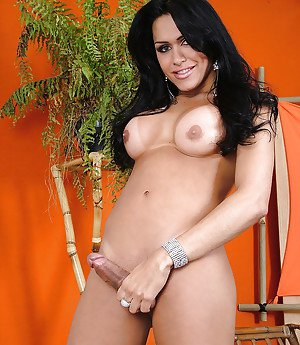 Busty Latina shemale Ivana releasing large cock from panties
