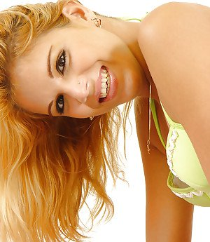 Blonde solo shemale Fabiane Spears modeling in high heels and skirt