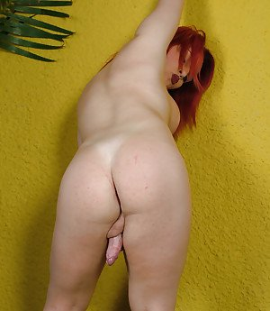 Redheaded solo tranny Biatrix Brianny flaunting big tits and long cock