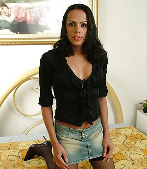 Solo ebony shemale Valentiny Sampaio posing in stockings with hanging cock