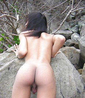 Skinny Asian shemale Ho showing off nice legs and masturbating outdoors
