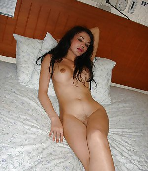 Solo Asian tranny Lisa revealing large boobs and hairy cock under panties