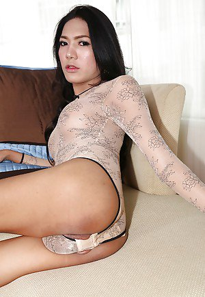 Solo brunette Asian tranny Nan spreading for big shaved cock exposure
