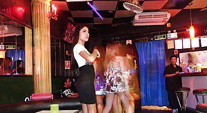 Group of non nude Asian shemales flirt and tease in public