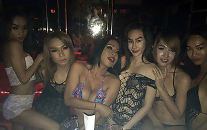 Asian trannies flashing tits and grinding while dancing in strip club